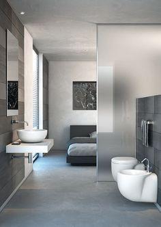 #reforma #baño abierto al dormitorio con separación vidrio translúcido, sanitarios al aire, suelo microcemento.: