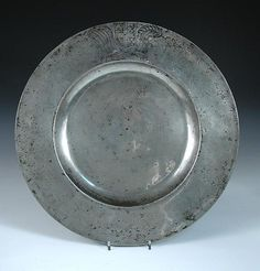 A large 17th century pewter charger,