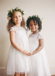 The sweetest flower girls: http://www.stylemepretty.com/2016/05/20/the-ceremony-backdrop-a-staircase-filled-with-candles/ | Photography: Kendra Elise - http://www.kendra-elise.com/