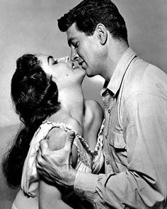 Rock Hudson, the studly man on the right grasping Elizabeth Taylor in a passionate embrace