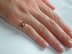 Gouden ring met robijnen en diamanten