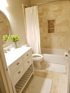 Small bathroom remodeled with travertine walls and floor.