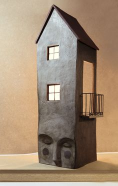 symbol combining two -- house, head. Irma Gruenholz