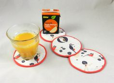 Fairtrade orange juice with coasters made with our In The Trees and Ladybird Red Fairtrade certified cotton fabric #fairtradefortnight #fairtrade #youeattheyeat #cotton