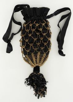 ~Woman's Reticule United States, circa 1860 Costumes; Accessories Bronze beads, silk satin, cantaloupe seeds~