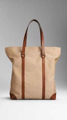 Cotton Gabardine Tote Bag | Burberry $895.00 Item 38803691 DARK OCHRE         Heritage cotton gabardine tote bag with leather trim         Clasp closure, interior pockets         35 x 44 x 11.5cm         13.8 x 17.3 x 4.5in         100% cotton with leather trim         Imported