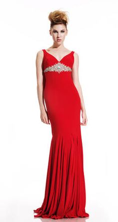 Red stretch jersey and form fitting, this dress embodies a classic silhouette with a twist. Including a hand beaded empire waist and an embellished cowl back, this gown can command a room coming and going.