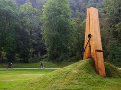 Professor Mehmet Ali Uysal's giant clothespin, Liege, Belgium. Man, this looks like it HURTS.  I really like how the used the land scape and I would want to scalp something like this because of the proportions