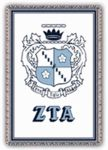 """Our Zeta Tau Alpha Afghan is an elegantly woven sorority throw and measures 48""""x68"""".  It also carries the Zeta Tau Alpha Greek letters and crest. A distinctive gift for a new active or loyal alum! Washable. Available in many Fraternity"""
