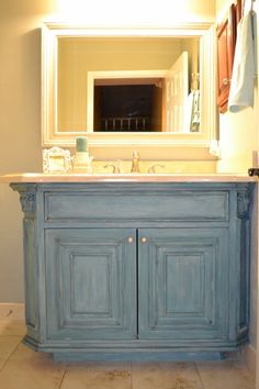 Converted a Traditional dark stained vanity into a French country statement piece using chalk/milk paint