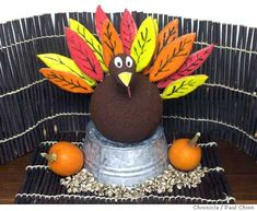 A cooler kids table with Thanksgiving Centerpiece stuffed with edible feathers. - OCCASIONS AND HOLIDAYS