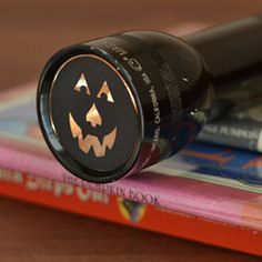 Flashlight with DIY filters! I know this is showing a halloween filter, but the same concept can be used while camping.  Wouldn't it be great to make a scary flashlight filter to go along with your campfire stories or when walking around the campground at night?  Kids will love this!