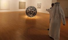 """""""The World I Love the Most"""" by artist Ghada Amer inside a hall that is hosting a pre-opening exhibition which introduces the future Guggenheim Abu Dhabi's collection, in Saadiyat Island on November 2014 © Karim Sahib - AFP"""