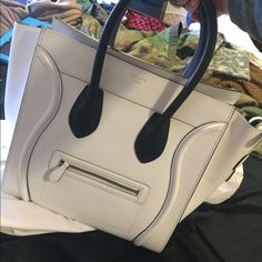 Celiné Fall 2013 white calfskin Mini Luggage Another beautiful peice by Celiné, White with black handles, only carried twice! I have my everyday bag carrier but I think I want a black Celiné so I'm sacrificing this one for a black one  I do prefer ️️ (no one wants to fork over any $$ they made, and it will be cheaper lol) $1900 with usps priority; tracking available and signature required  shopping bag will come seperatly so the bag will not be damaged Celine Bags Totes