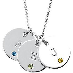 Initial circles with birthstones, available in your choice of metal yellow or white gold and sterling silver.