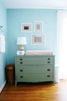 This gorgeous antique chest was painted with Martha Stewart Living's Pumpkin Seed. It's being used as a changing table in this adorable nursery! | From Jennifer of The Newlywed Diaries