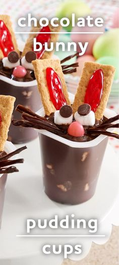 Chocolate pudding cups with mini marshmallows stirred in are decorated with graham crackers and sweets to make faces for bunny pudding!