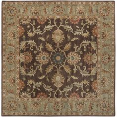 This gorgeous chocolate hand-tufted wool rug features rust, sage, beige, tan, and gold colors on a chocolate-colored background. These colors are all integrated into the rug's elaborate and ornate design that is inspired by traditional rugs.
