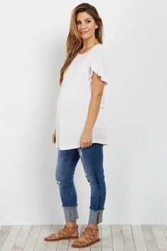 Step up your basics with this feminine maternity top. A short sleeve top that is perfect to keep cool in when the weather gets warm. Wear this top with maternity jeans and boots for a chic ensemble you can wear for any casual occasion.