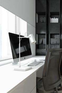 There's just something simplistic and wonderful about this office decor! The black & white furniture make this minimalist office great inspiration for your own workspace!