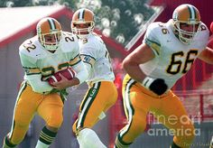 Photograph taken of Edmonton Eskimos running back Blake Marshall #22 receiving a hand off from QB Damon Allen #9 on this play. Taken during Labour Day game in Calgary, 1988.