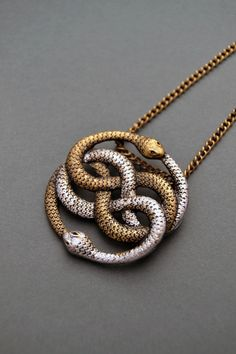 Auryn necklace Infinite snake necklace Snake jewelry Snake knot necklace Ouroboros necklace Auryn pendant Neverending Story gift by ValkyriesSong on Etsy https://www.etsy.com/listing/207764156/auryn-necklace-infinite-snake-necklace