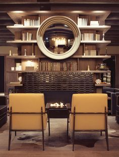 [CHICAGO] Thompson Hotel -- open library shelves around the #fireplace look modern, not stuffy