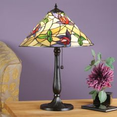 Prairie Table Lamp by Interiors 1900 A mackintosh rose with a modern twist on a flowing background. H:	580 W:	420 D:	420 Bulbs:	1 x 60 E27 Fittings:	RB159M Shade:	T014SH40