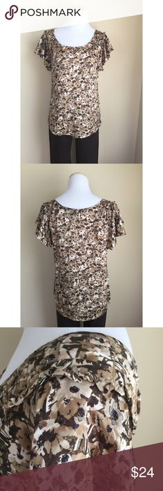 "Banana Republic silk floral top sz S Banana Republic silk top, size S.  Pretty floral pattern in shades of brown, taupe, and blush.  Ruffle sleeves with pleated seaming detail, small ruffle trim has natural unfinished edge.  Popover style, rounded hemline, contoured shape.  Condition:  very good pre-loved.  Material:  100% silk.  Measurements (approximate, taken laying flat): length 24"", pit-to-pit 18.5"", flat waist 17"", flat hip/hem 19"", sleeve 4.5"". Banana Republic Tops Blouses"