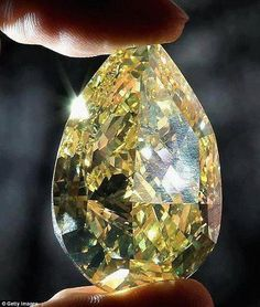 The Cora Sun-Drop Diamond is the largest yellow pear-shaped diamond known, weighing 110.3 carats (22.1 g). Being sold for $10.9 million it has set a world record for a yellow diamond..