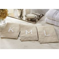 18 letters:  A, B, C, D, E, F, G, H, J, K, L, M, N, P, ?R, S, T and W. Natural linen towels feature hand-knotted ?French knot initial design.
