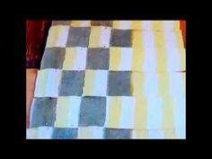 Make a bath mat from a towel.