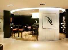 nespresso opens in toronto s swanky yorkville azure magazine commercial interiors. Black Bedroom Furniture Sets. Home Design Ideas