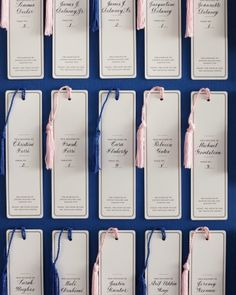 Bookmark Escort Cards    In keeping with the literary theme of this couple's reception location, letterpressed bookmarks, calligraphed with attendees' names, led them to their seats.