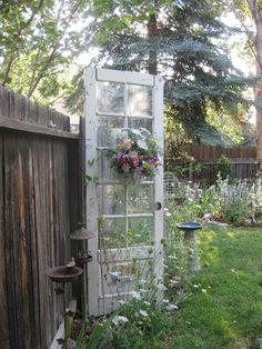 Reuse an old door in the garden...love this.