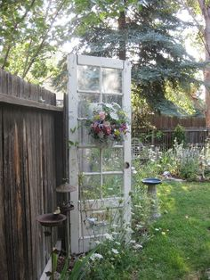 Reuse an old door in the garden...love this.