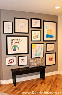 3 Ideas For a Kids Art Gallery Wall (Our Home) - Kylie M Interiors.  Display shown on Sherwin Williams Pewter Tankard with a black distressed farmhouse style bench and black frames with white mats.