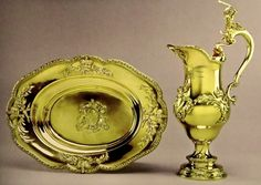 CORONATION PLATE: Christening Basin & Ewer, C.1735. These were used for the baptism of the future George III in 1738. The figure of Hercules slaying the Hydra is represented on the handle of the Ewer.