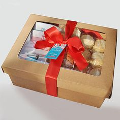 Lazy Afternoon Tea And Games Box £112 - this version is a total rip off, but an idea easy to re-implement. Some tea, custard creams or very british biscuits and novelty items, and hey presto.  Could perhaps be a 'Highland Christmas' box or something.  Would use up the whisky!