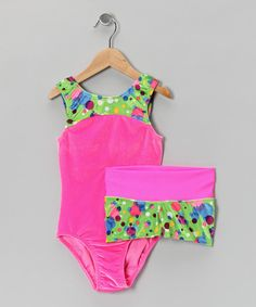 This showstopper of a set has a luxe velvet leotard that is a comfy delight. Tumble-ready shorts with an elastic waistband offer added coverage to the gymnast in need. Includes leotard and shorts90% polyester / 10% spandexMachine wash; tumble dryMade in the USA