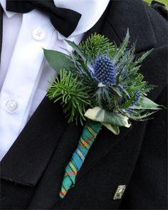 Tartan buttonhole at a Scottish wedding