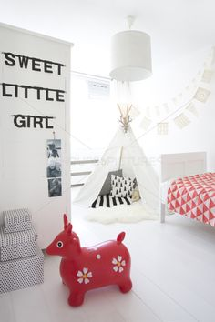 modern girl's bedroom that isn't too girly | sweet little girl banner in black | white teepee with black and white pillows