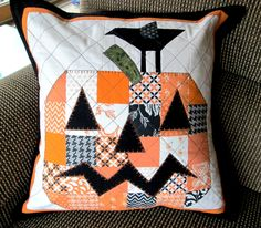 """Patchwork pumpkin quilted pillow cover. Orange, white and black patchwork pumpkin and blackbird. Quilted pillow cover only for 18"""" insert by CottonandWhimsy on Etsy Handmade Pillow Covers, Pumpkin Faces, Blanket Stitch, Quilted Pillow, Blackbird, Decorative Cushions, Black Fabric, Tree Skirts, Quilt Blocks"""