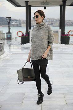Gala Gonzalez in a grey oversized sweater + black miniskirt + black tights + black heels