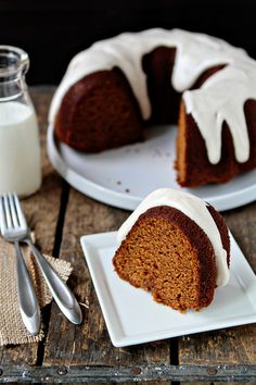 Sweet and spicy pumpkin bundt cake drenched with a rich and creamy spiced cream cheese frosting.