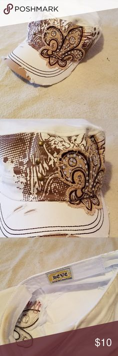 Fleur de lis Rhinestone Ball Cap Rhinestone Fleur-de-lis cadet style ball cap, distressed look, white and tan. Worn only once. Accessories Hats