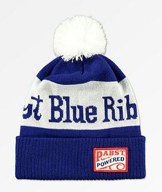 Perfect for fans and collectors alike, Spacecraft presents the PBR Blue Pom Beanie. This warm knit accessory features Pabst Blue Ribbon logo script on the crown while a signature logo patch is stitched on the fold-over cuff. Beanies, Beanie Hats, St Blues, Ribbon Logo, Hat Patches, Pabst Blue Ribbon, Black Characters, Patch Design, Knitting Accessories