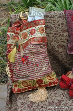 Bag, trimmed with wonderful tapes, embroidery, using bracelets to hang cords and tassels, created by La Bastidane, in the Luberon area of Provence
