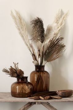 Pampas grass is the new and improved house plant. Pampas grass is wispy, elegant, and neutral instantly improving any space! Pampas grass pairs perfectly with a faux concrete planter as a tablescape centerpiece! Tall Glass Vases, Tall Vase Decor, Decoration Entree, Grass Decor, Apartment Chic, Pampas Grass, Aesthetic Rooms, Home Decor Inspiration, Decor Ideas