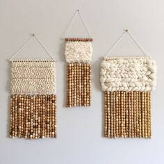 white woven wall hangings with wood beads